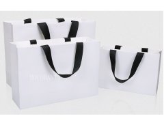 White paper bag with black ribbon